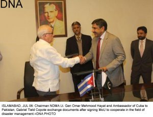 ISLAMABAD, JUL 06: Chairman NDMA Lt. Gen Omar Mehmood Hayat and Ambassador of Cuba to Pakistan, Gabriel Tield Copote exchange documents after signing MoU to cooperate in the field of disaster management.=DNA PHOTO