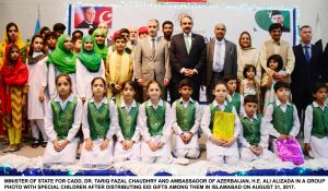 MINISTER OF STATE FOR CADD, DR. TARIQ FAZAL CHAUDHRY AND AMBASSADOR OF AZERBAIJAN, H.E. ALI ALIZADA IN A GROUP PHOTO WITH SPECIAL CHILDREN AFTER DISTRIBUTING EID GIFTS AMONG THEM IN ISLAMABAD ON AUGUST 31, 2017.