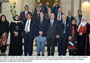 ISLAMABAD, NOVE 28: Leader of the House in Senate Raja Zafar ul Haq and others in a group photo on the occasion  of a dinner hosted by Ambassador of Palestine Walid Abu Ali for visiting Assistant Minister of Palestine Dr. Mazem  Shamiah, at Palestine House. DNA PHOTO