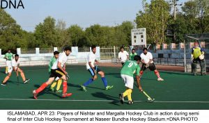 ISLAMABAD, APR 23: Players of Nishtar and Margalla Hockey Club in action during semi final of Inter Club Hockey Tournament at Naseer Bundha Hockey Stadium.=DNA PHOTO